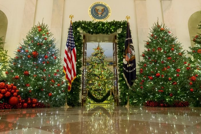 Presidential seal is seen above an entrance to the Blue Room where the official White House Christmas tree is