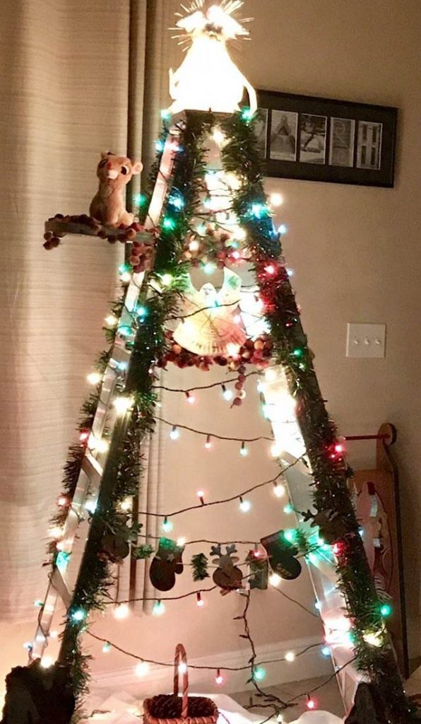 susan walsh of winter springs florida writes thank you country woman magazine for the idea of decorating an old ladder it truly is a step up from