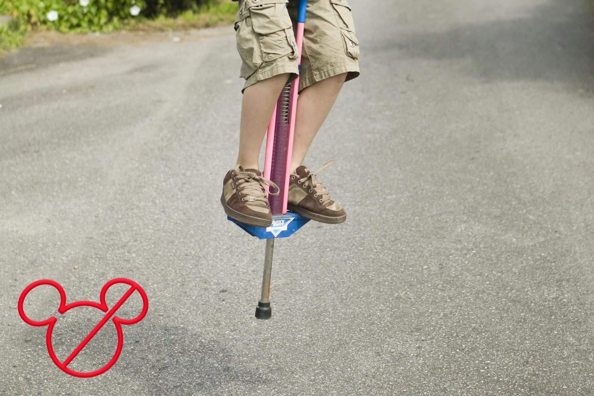 kid on a pogo stick