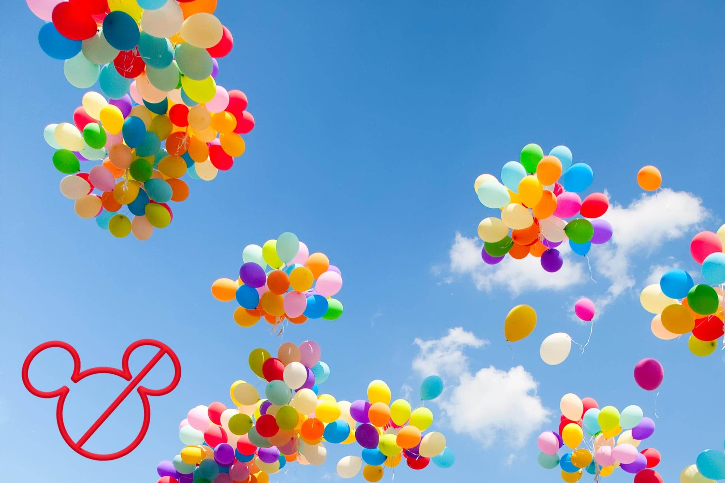 bunches of balloons floating away