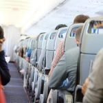 The Etiquette Rules of Getting Up to Use the Airplane Bathroom (When Your Neighbor Is Asleep)