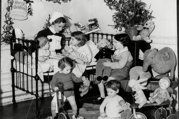 A Nurse With Children Surrounded By Christmas Presents At The Children's Hospital Hampstead - Christmas 1936.