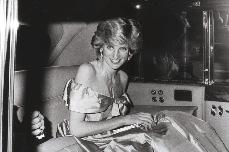 Diana The Princess Of Wales Arrives At The Queens Theatre For The Charity Performance Of Noel Coward's Play 'hay Fever'. Diana Was Wearing A Blue Silk Off The Shoulder Evening Gown / Dress... For Mail On Sunday Supplement Charles The Prince's Sto