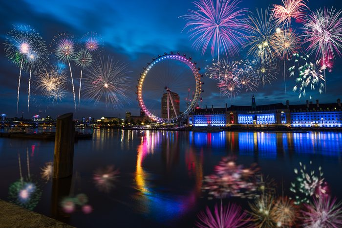 LONDON,ENGLAND - DECEMBER 31,2015: London Eye and Queen's Walk with Fireworks
