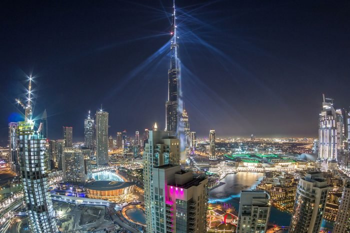 Dubai downtown cityscape with Burj Khalifa, LightUp light show aerial timelapse from rooftop. With the largest light and sound show on a single building The United Arab Emirates city of Dubai has