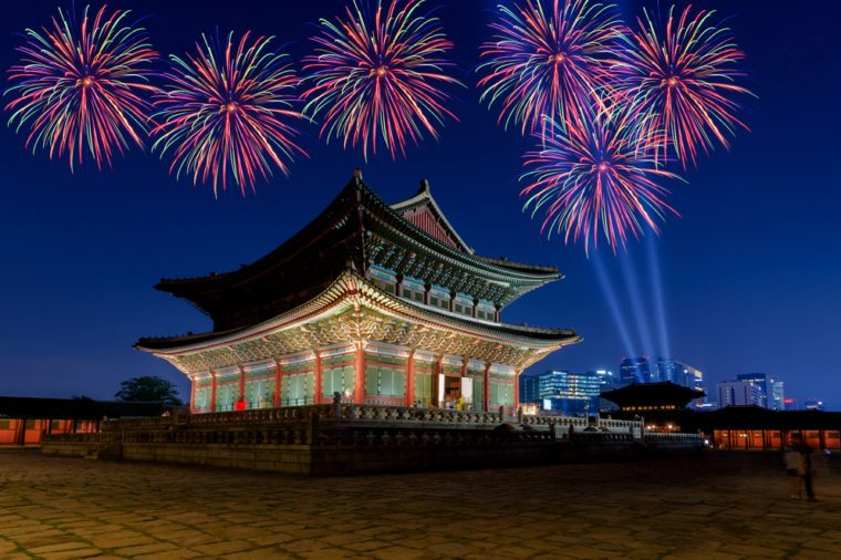 Colorful fireworks and Gyeongbokgung palace at night in Seoul, South Korea