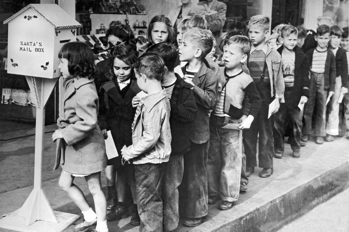 Downey, California: 1947. A group of children line up to mail their letters to Santa at special mail boxes set up through out the town by the Chamber of Commerce. Volunteer women will answer each letter.