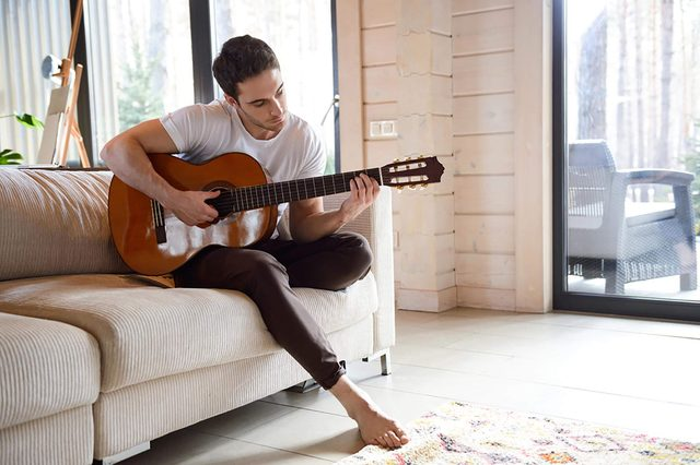 Man-Playing-Guitar