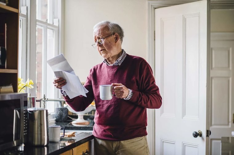 Elderly-man-reading-bills