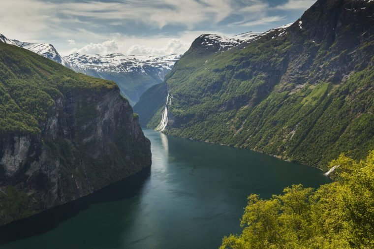 Seven Sisters waterfall. Geiranger fjord view from Road Of The Eagles mountain serpentine. Scenic Norway nature landscape.