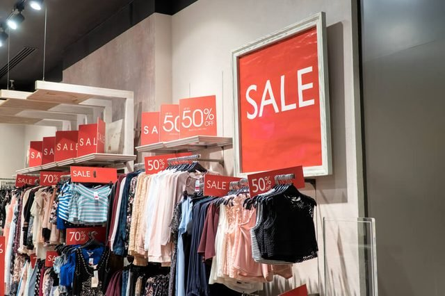 Sale label sign in front of shop,Sale shopping season for discount display,Sale marketing business advertisement for clearance shop,Sale sign or label most use red color for tell customer.