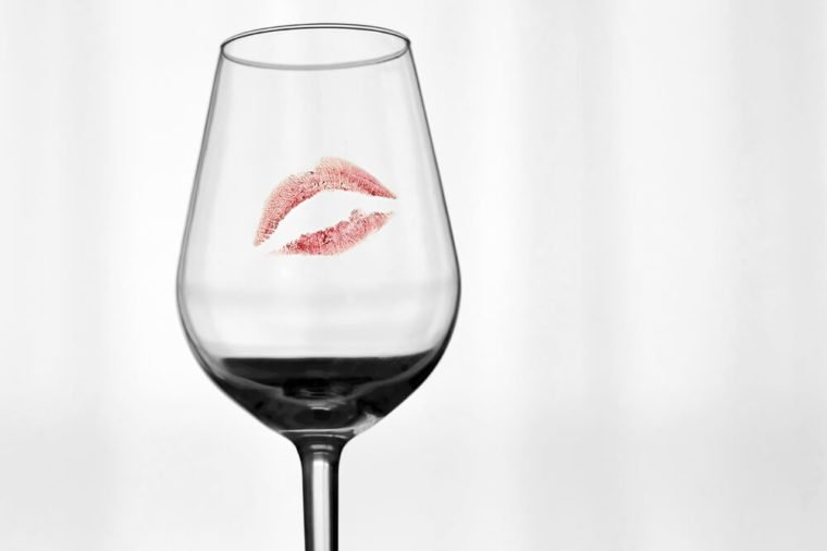 A red mark of a lipstick on a glass.