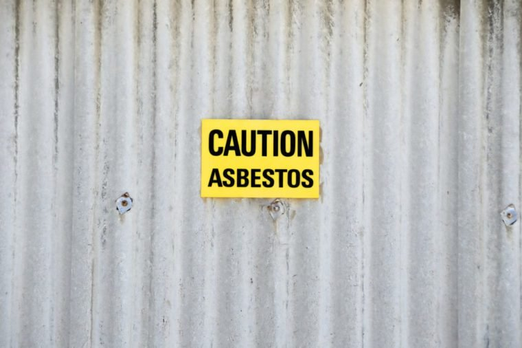 Sign with text: Caution asbestos