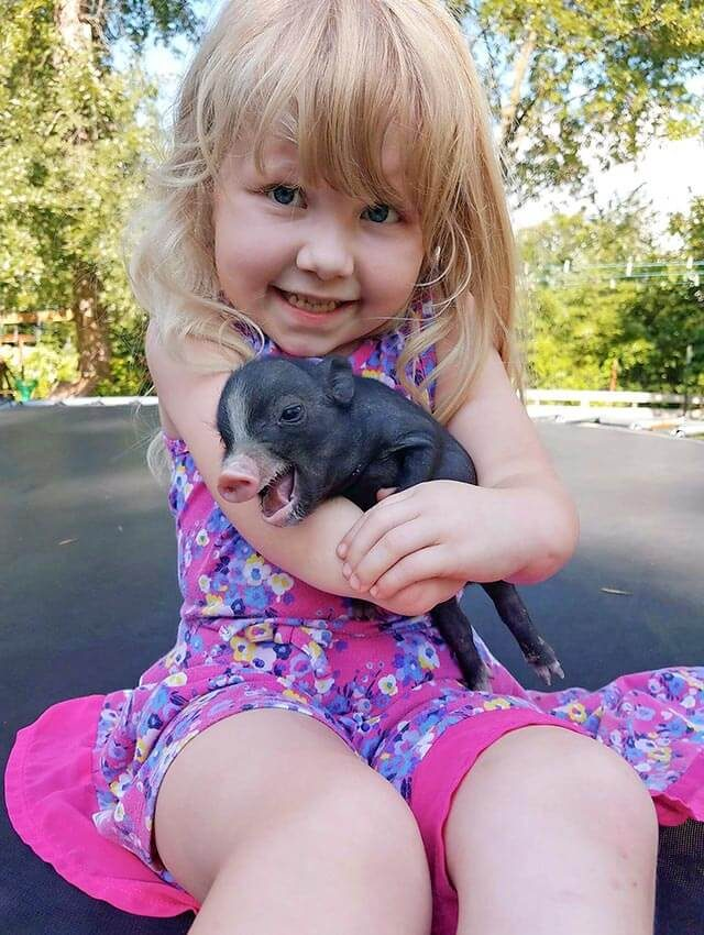 Girl-with-baby-pig
