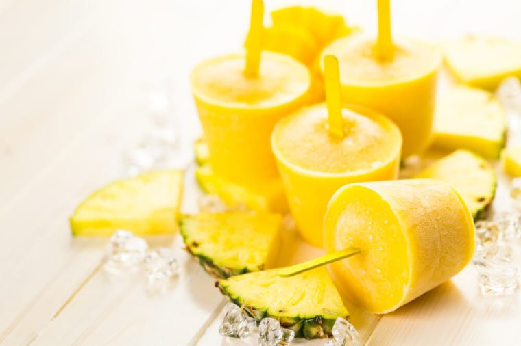 Homemade low calorie popsicles made with mando, pineapple and cocconut milk.