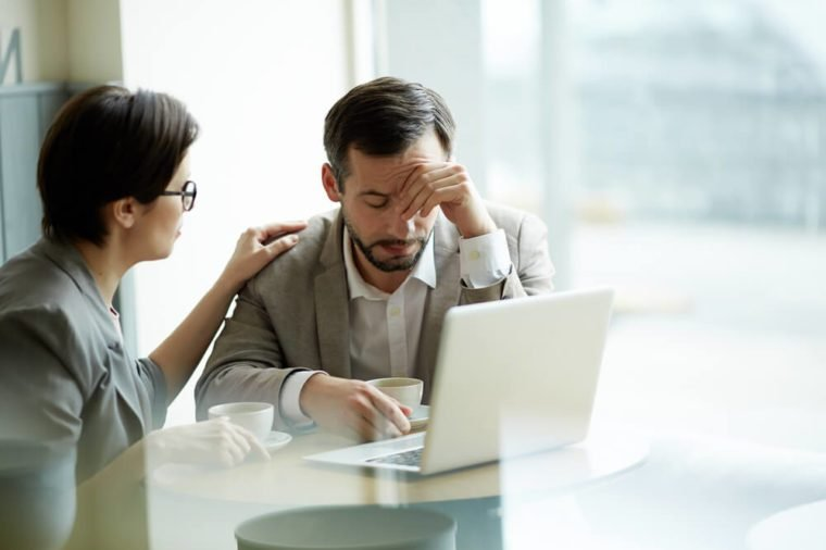 Businesswoman comforting frustrated or tired co-worker