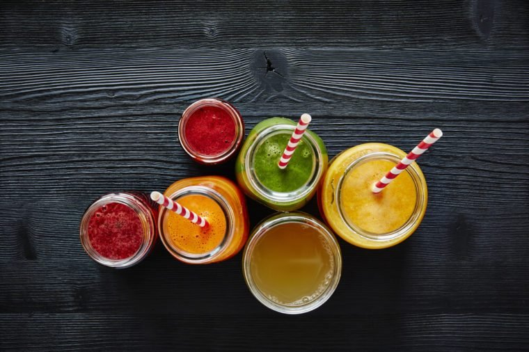 a bunch of colorful organic smoothies ready to drink