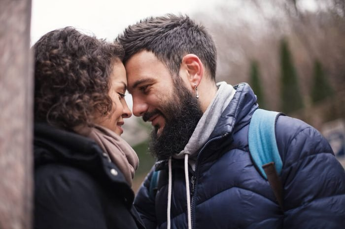 A man and a woman are looking at each other, close-up. Second before the kiss.