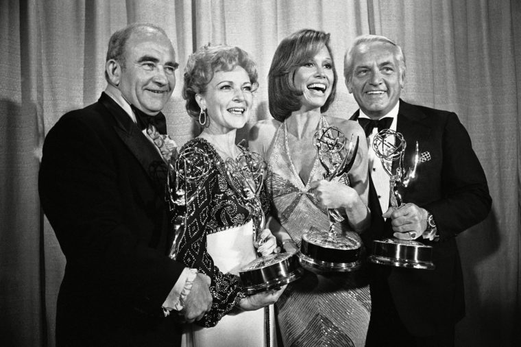 """Mary Tyler Moore, Ed Asner, Betty White, Ted Knight Cast members of the """"Mary Tyler Moore Show,"""" pose with their Emmys backstage, at the 28th annual Emmy Awards in Los Angeles. From left are, Ed Asner, who plays the news director on the show but won his Emmy for his role in """"Rich Man Poor Man""""; Betty White, supporting actress; Ms. Moore for best actress in a comedy show and Ted Knight for supporting actor. At 89, White has become a role model for how to grow old joyously 18 May 1976"""