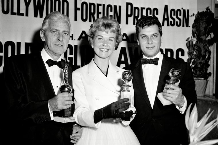 Day Curtis Adler Actress Doris Day, center, Tony Curtis, right, and Buddy Adler pose with their awards presented to them by the Hollywood Foreign Press Association at its annual awards dinner in the Cocoanut Grove in Los Angeles, Ca., . Day and Curtis were named best actress and actor in a poll conducted in 58 countries; Adler was presented the Cecil B. DeMille award by the association for outstanding contribution to the motion picture industry 26 Feb 1958