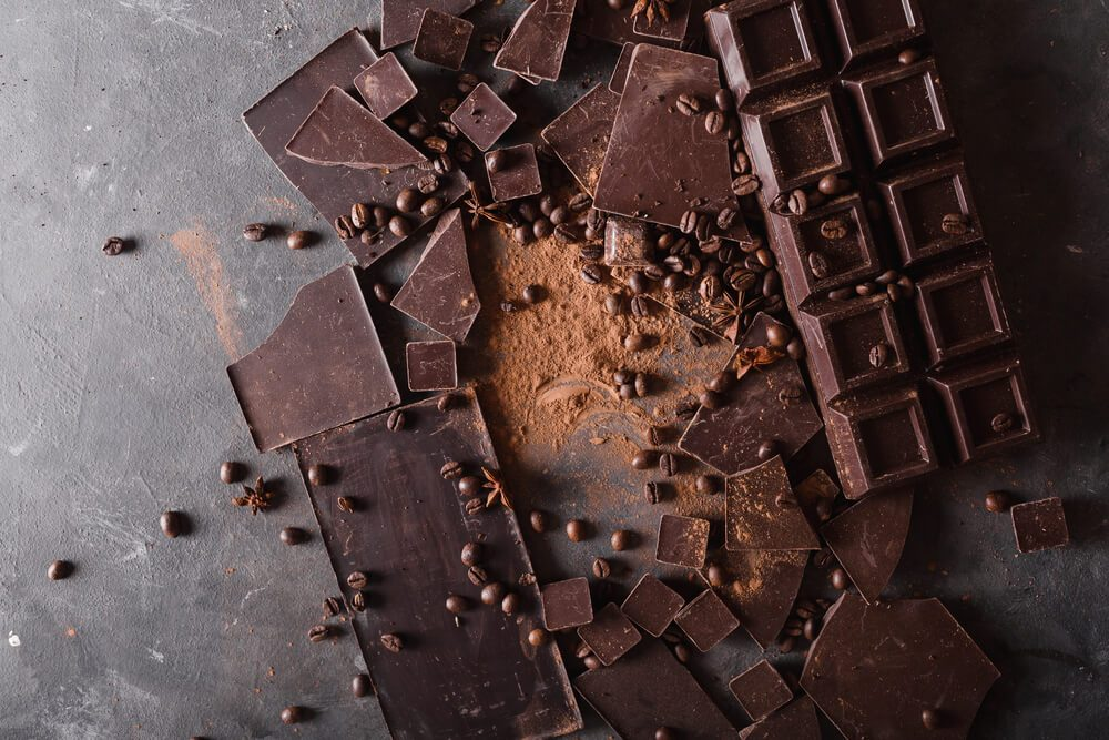 Chocolate chunks and cocoa powder. Sweet food photo concept.