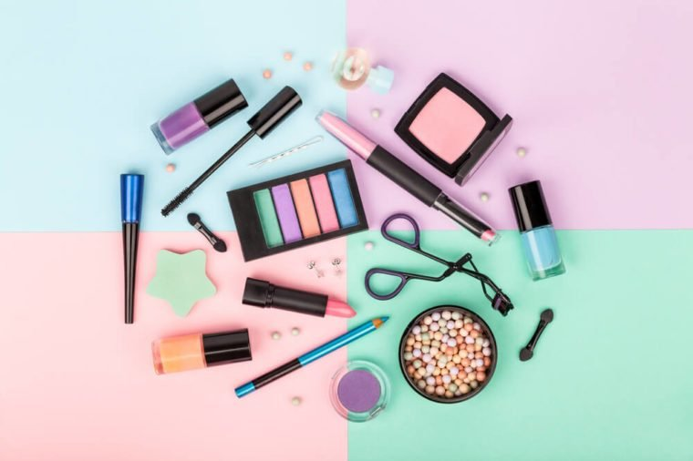 set of professional decorative cosmetics, makeup tools and accessory on colorful background. beauty and fashion concept. flat lay composition, top view