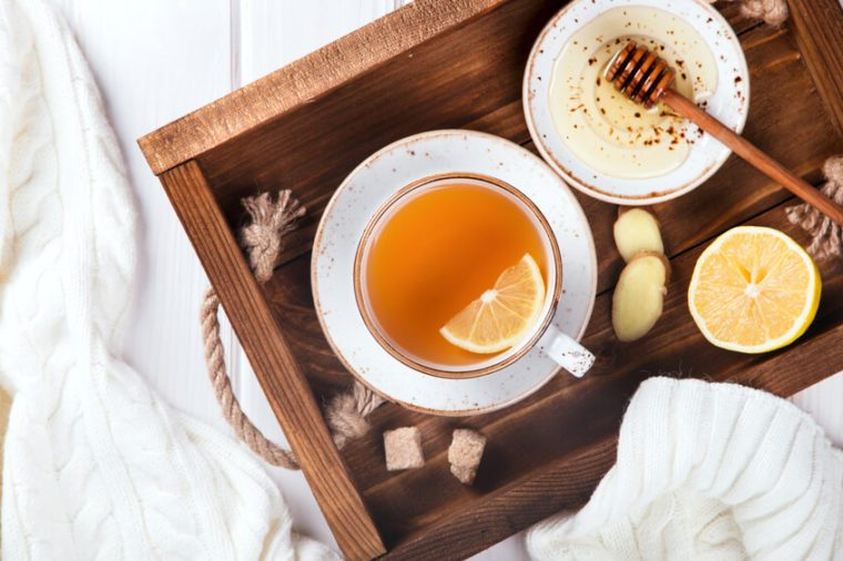 Cup of Ginger Tea with Lemon and Honey on a White Background.Concept Of Healthy Eating. top view. Copy space. selective focus.