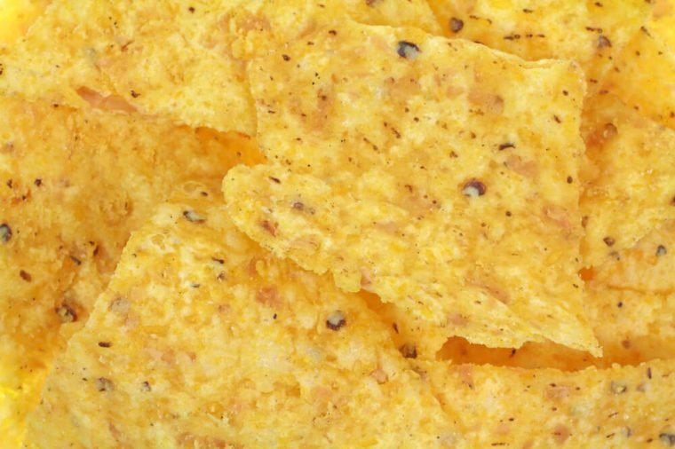 A close view of traditional yellow corn tortilla chips.