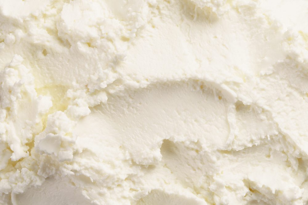 close up texture of cream cheese like ricotta, food background
