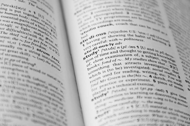 """Dictionary page with word """"study"""" in focus and other is defocused"""