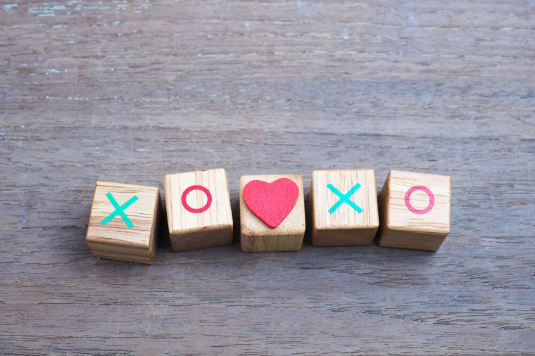 XOXO word written on wood cube.