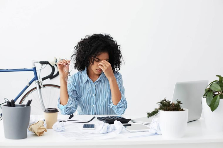 stressed-woman at her desk