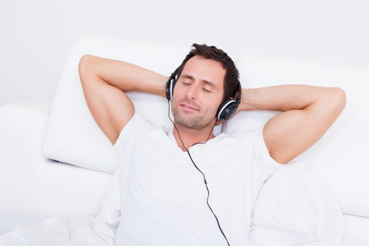 man-listening-to-headphones