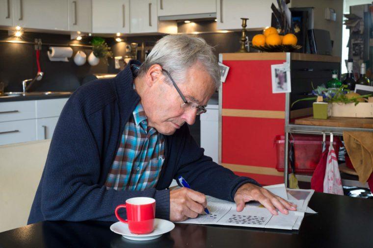 Elderly-man-solving-puzzle