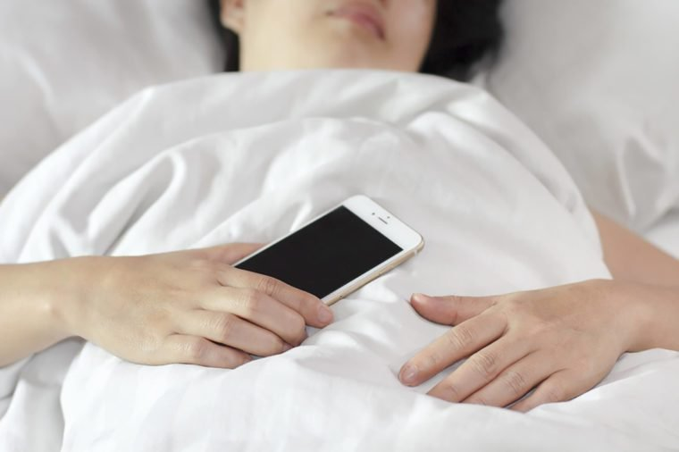 Woman-sleeping-with-phone