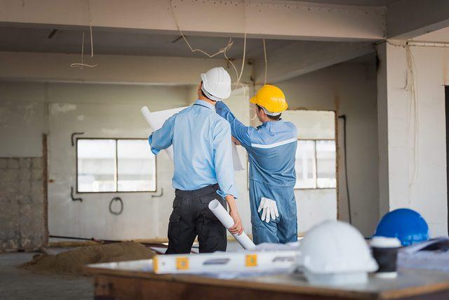 home renovation construction men fixing damp wall, wet wall, condensation, moisture