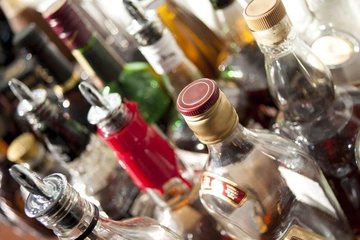 Alcoholic beverages in bottles at a bar.
