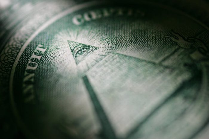 Selectively highlighted detail of the One Dollar Bill from the United States of America showing the Pyramid and the All Seeing Eye