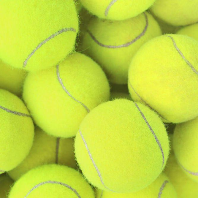 Lots of vibrant tennis balls