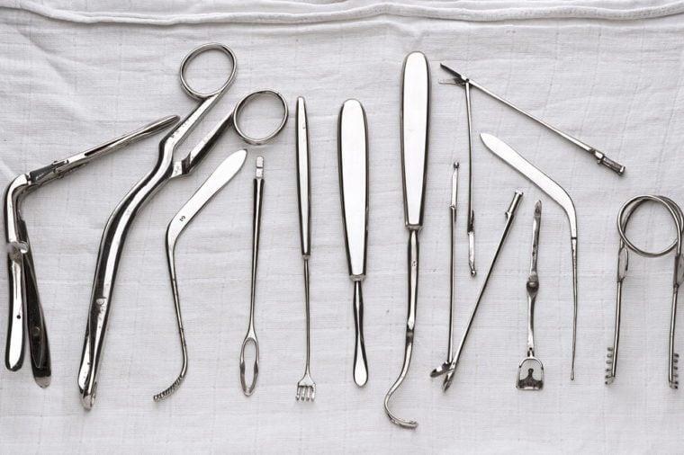 set of surgical instruments on white gauze