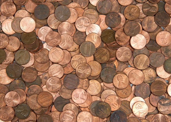 Flat view pennies. United States currency penny, many old new dirty clean viewed from directly above. The penny is the lowest denomination coin in the U.S. currency.