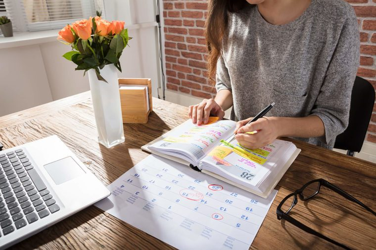 woman working on her planning schedule