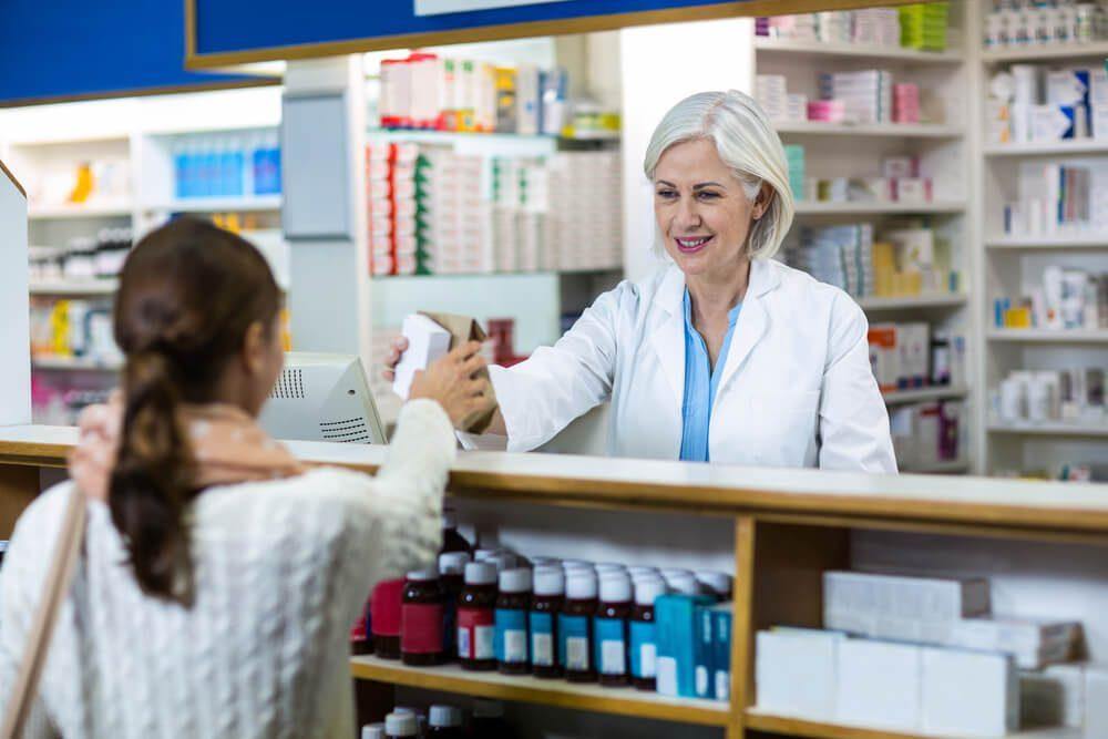 Kết quả hình ảnh cho Pharmacist giving prescription to customer