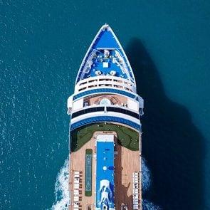 Large Cruise ship sailing across The Mediterranean sea - Aerial image