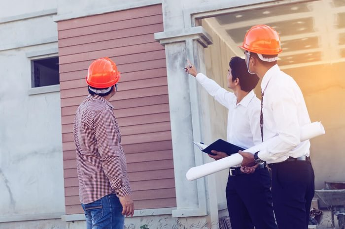 architect and engineer inspect housing estate building to success construction plan before send quality housing to customers