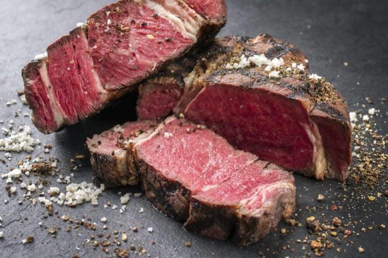 Barbecue dry aged Wagyu Rib Eye Steak as close-up on a slate