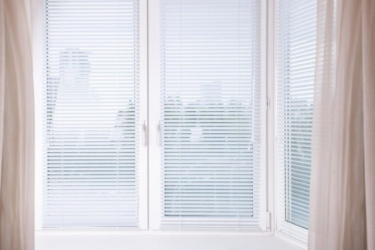 Horizontal image white Window with Venetian Blinds, Designer Blinds around the edges