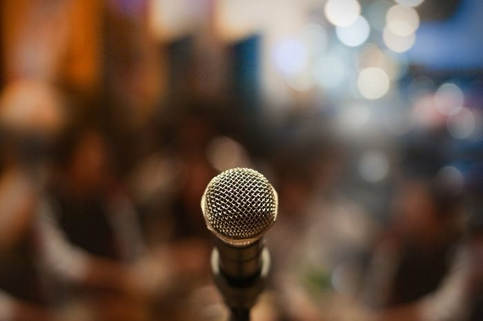 Close up of microphone on stage in audience room blur background.