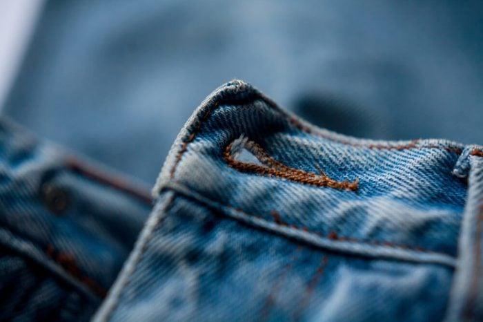 jeans button hole closeup fashion denim background