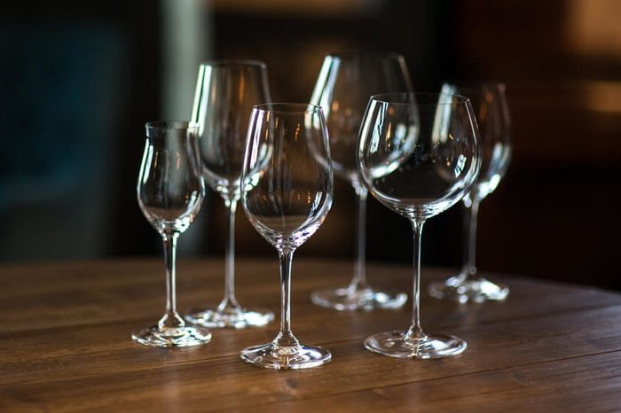 Different types of glasses for wine on wooden table. Still life concept.